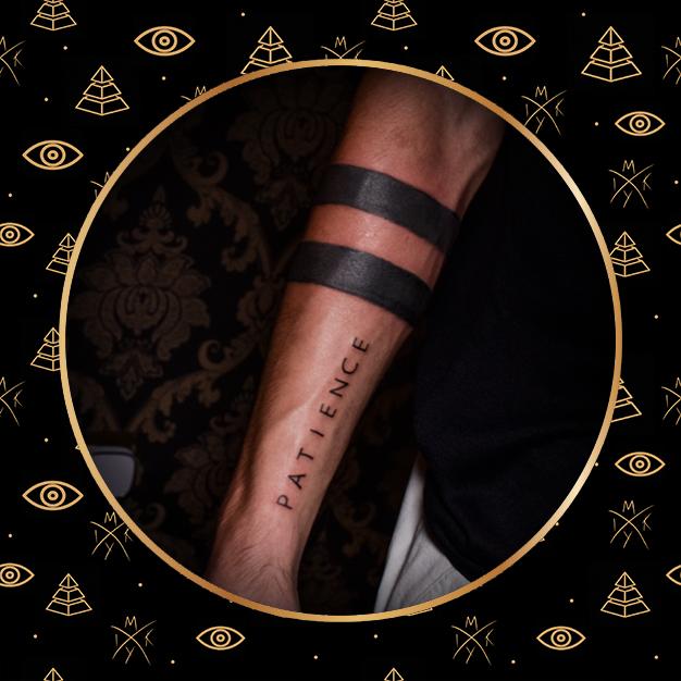 fasce nere con scritta tattoo fatto da Miky Ink Tattoo
